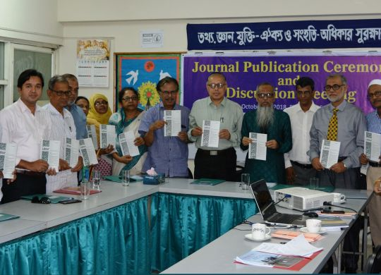 Guests unveil the BILS journal in the meeting
